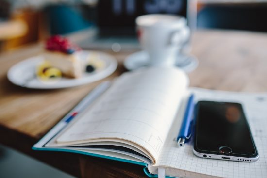 iphone-6-and-notebook-on-desk
